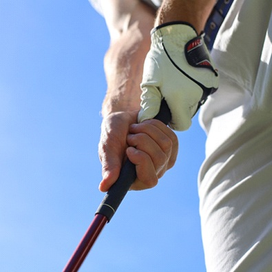 close-up of a golfer holding a club