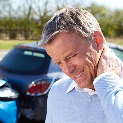 Man in pain holding neck