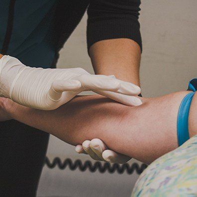 Doctor treating tennis elbow
